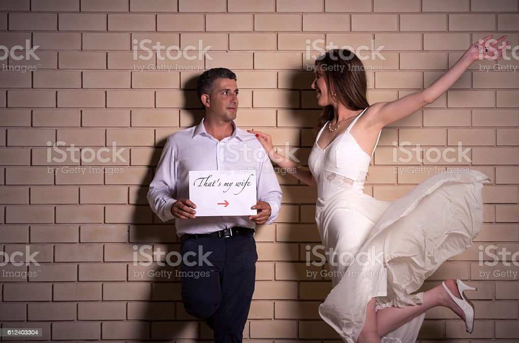 Man: 'That's my wife'. Woman: 'I'm his'. stock photo