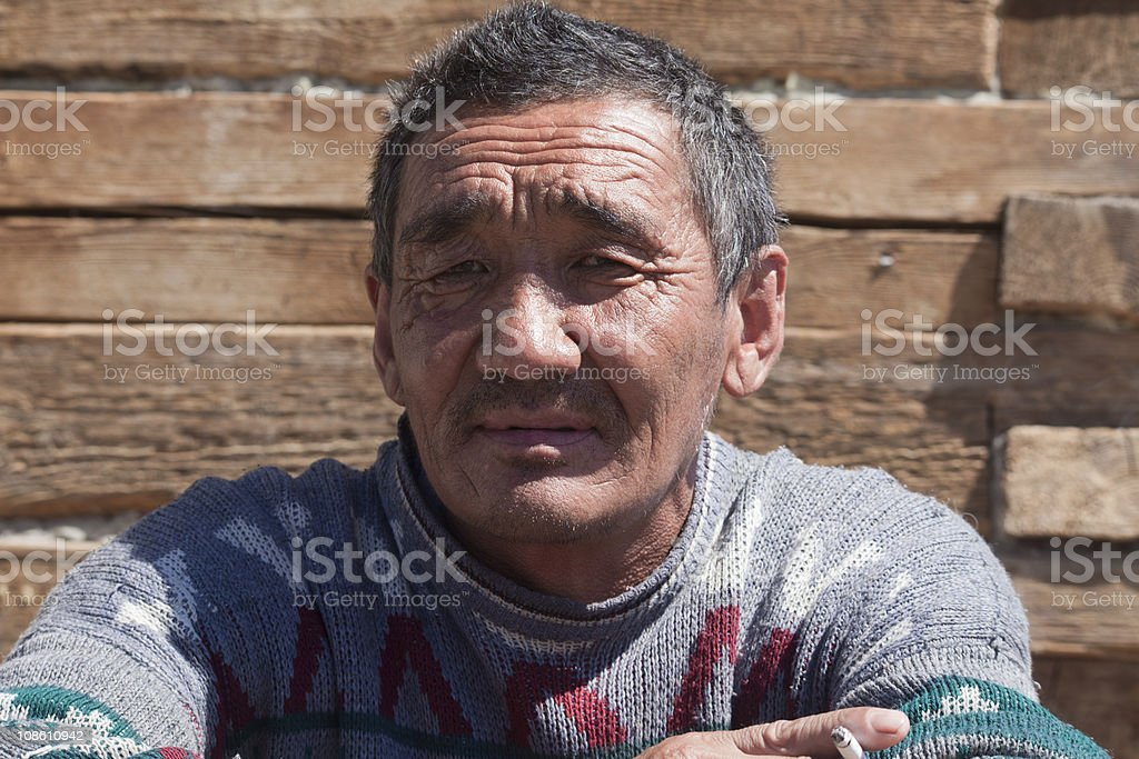 man the Asian sit and smokes a cigarette stock photo