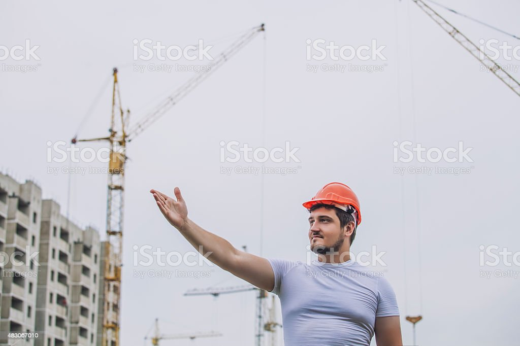 Man the Builder working foreman in the helmet to ensure stock photo