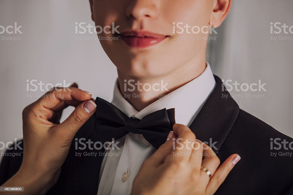 Man the groom in a wedding costume with butterfly smiles. stock photo