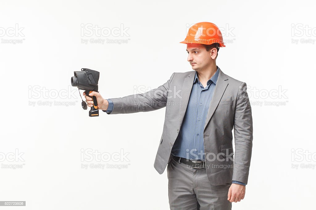 man thermometer in hand thermal imaging camera stock photo