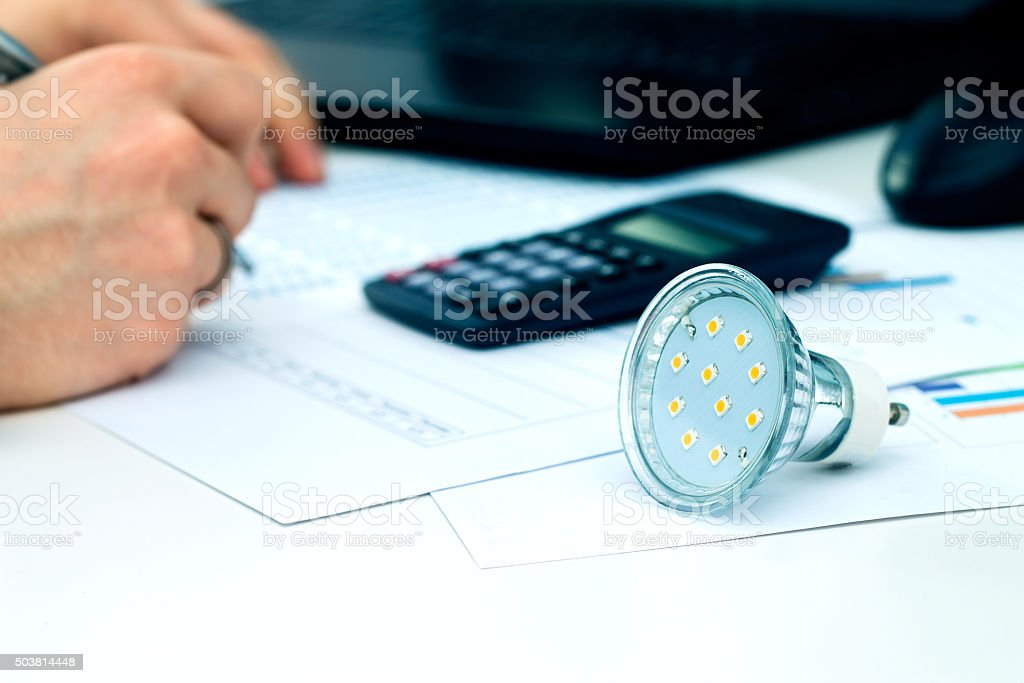 Man thinking about saving money. New solutions in energy saving stock photo