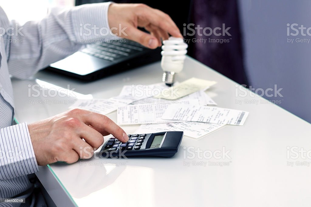 Man thinking about saving money. New solutions in lighting stock photo