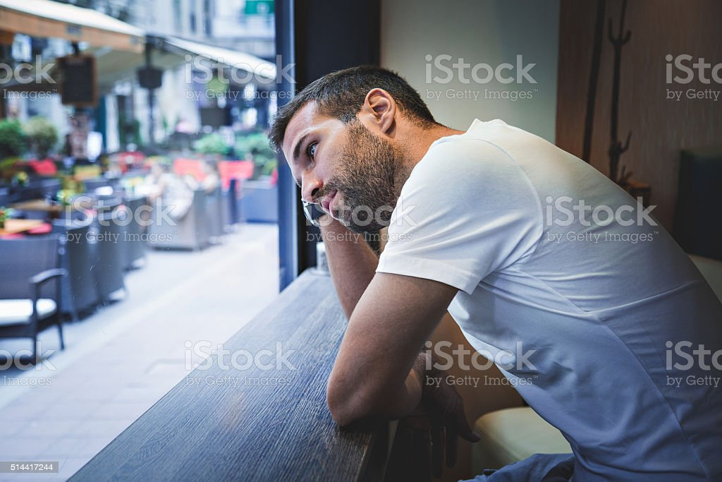 Man thinking by the window stock photo