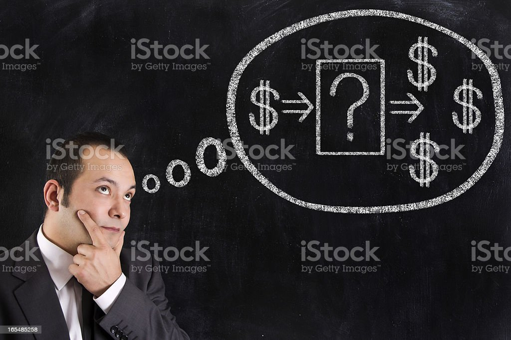 A man thinking next to a question mark and dollar signs stock photo