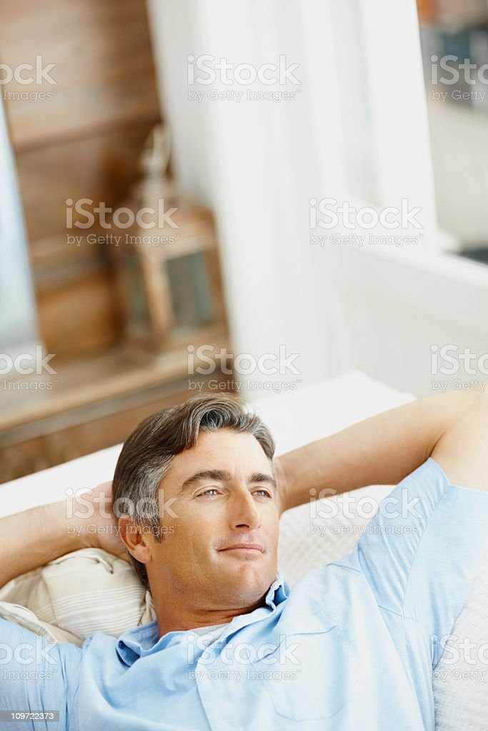 Man thinking on a couch royalty-free stock photo