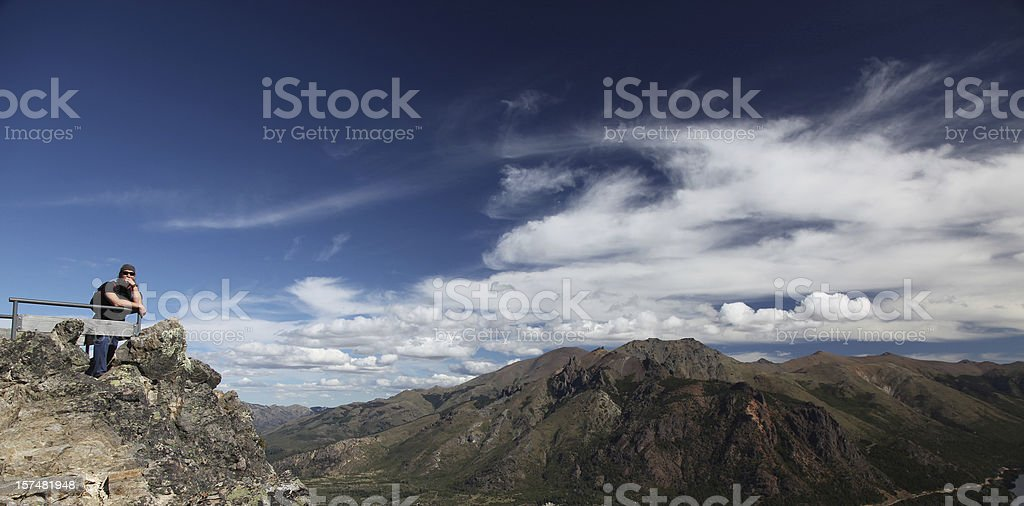 Man thinking with mountain landscape, Bariloche, Argentina stock photo