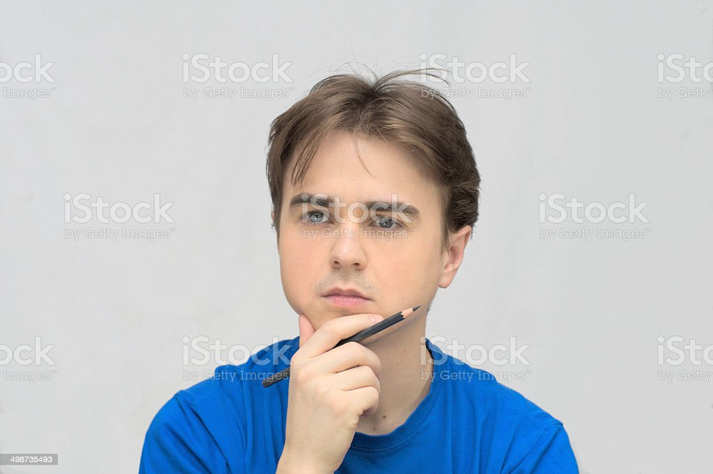 Man thinking with pencil stock photo