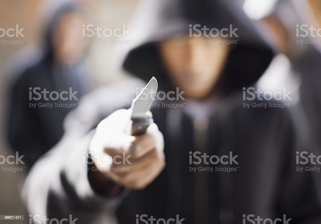 Man threatening with pocket knife royalty-free stock photo