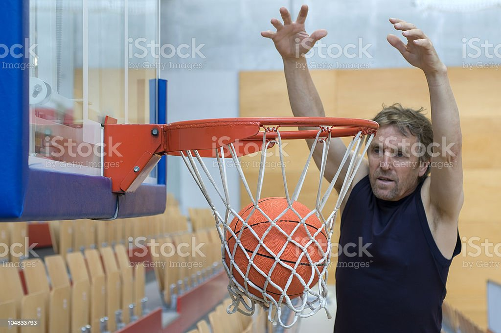 Man Throwing Ball in Hoop royalty-free stock photo