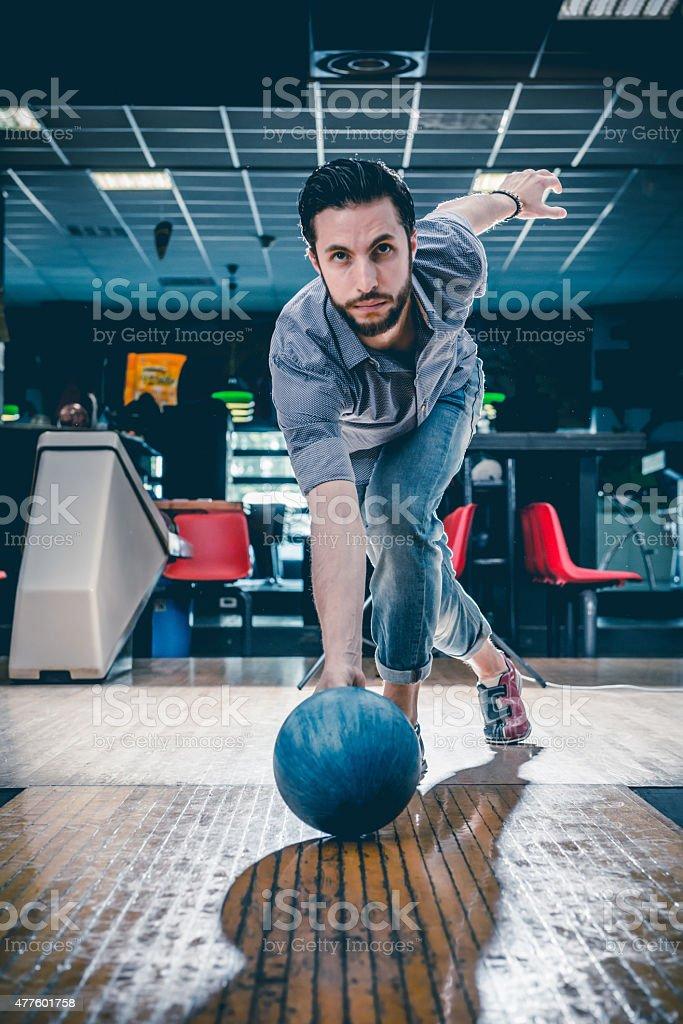 Man throwing bowling ball stock photo