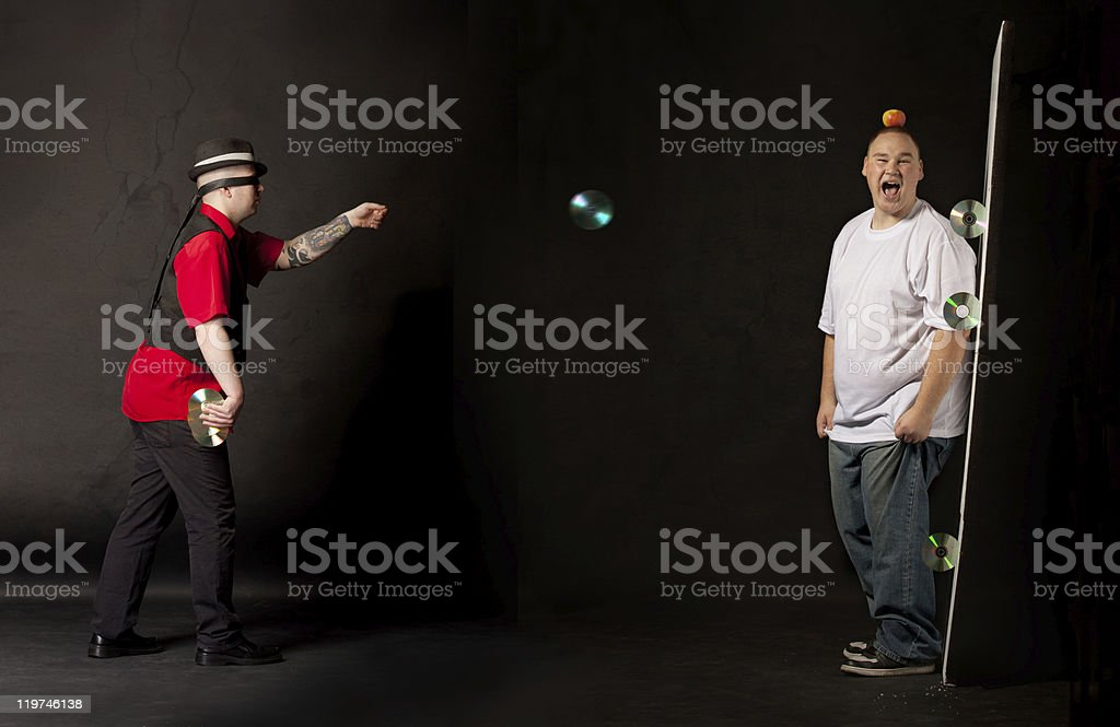 man throwing cds towards a victim royalty-free stock photo