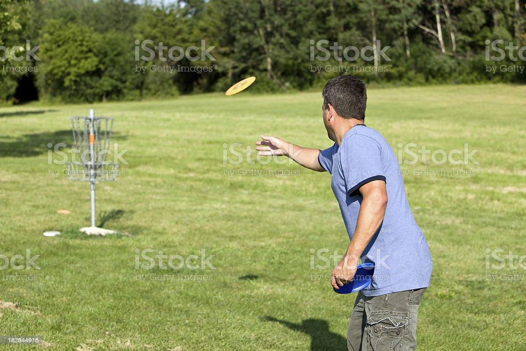 Man Throwing Golf Disk stock photo