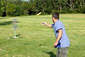 Man Throwing Golf Disk