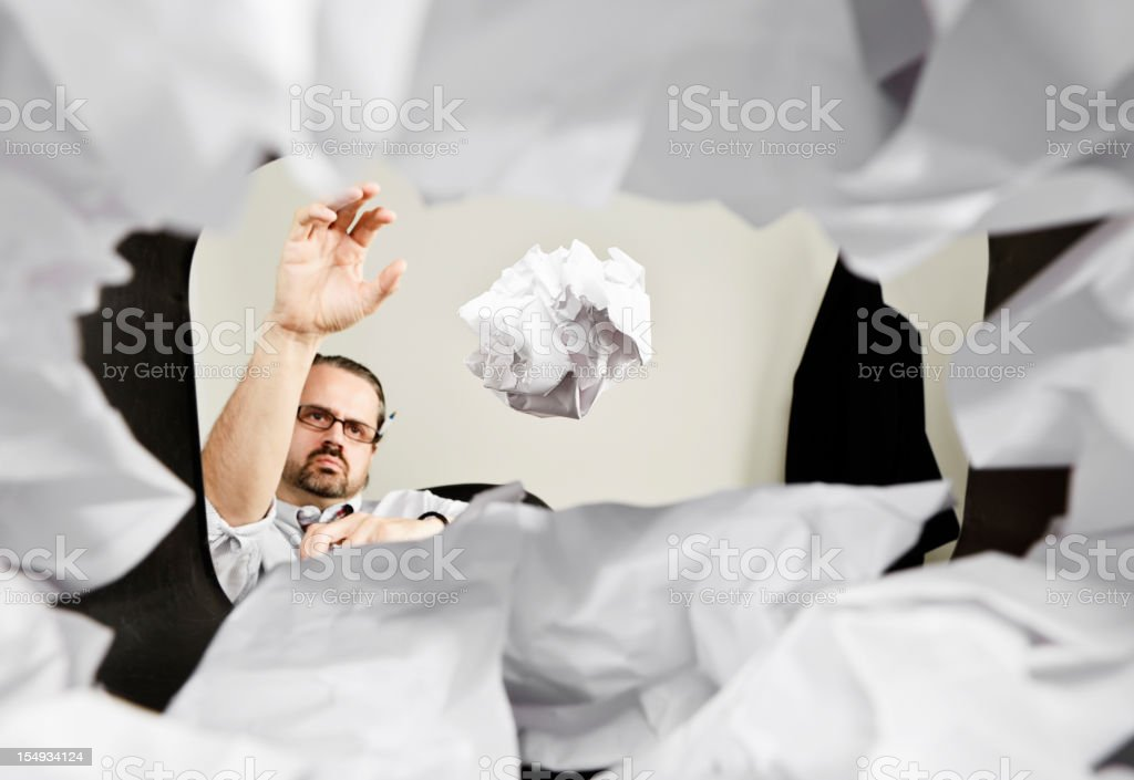 Man Throwing Paper Into Wastepaper Basket stock photo
