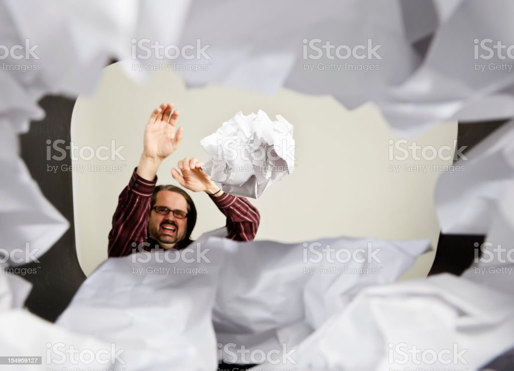 Man Throwing Paper Into Wastepaper Basket royalty-free stock photo