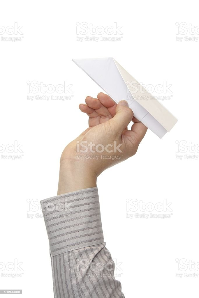 Man throwing paper plane stock photo