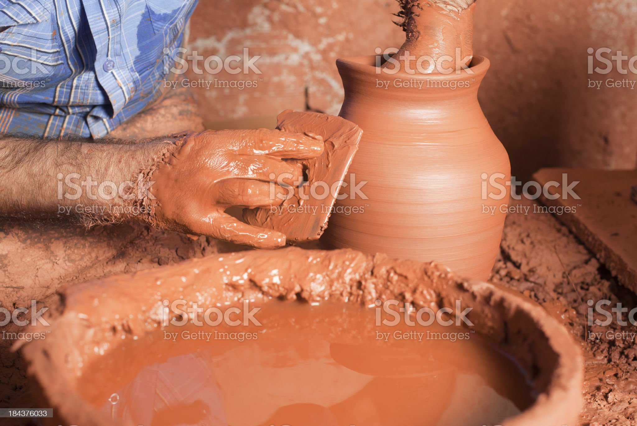 Man throwing pot on a pottery wheel royalty-free stock photo
