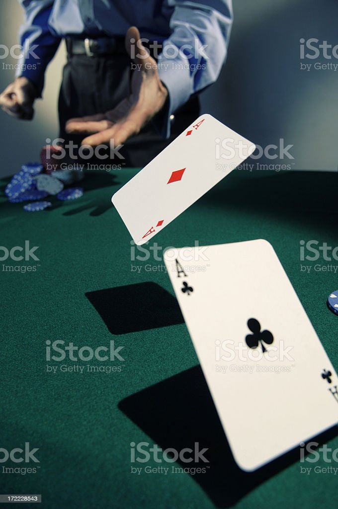 man throwing two aces royalty-free stock photo