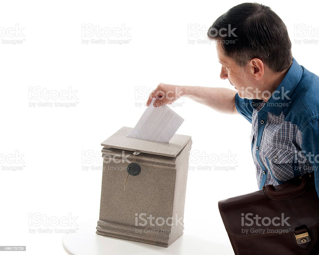 Man throws a letter in the mailbox stock photo