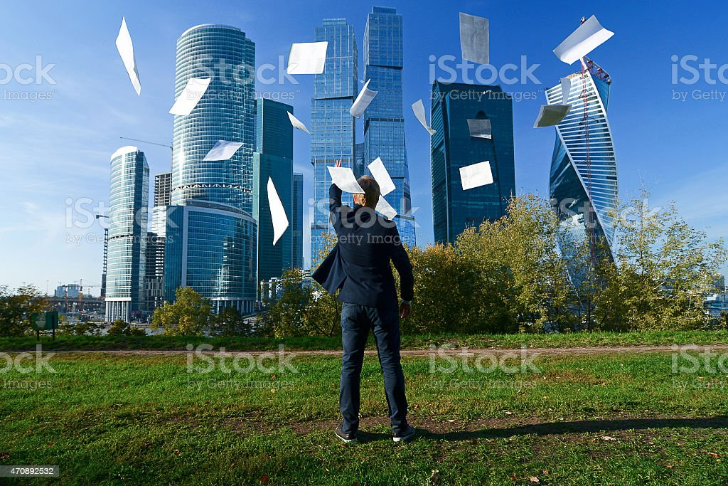 man throws paper sheets stock photo