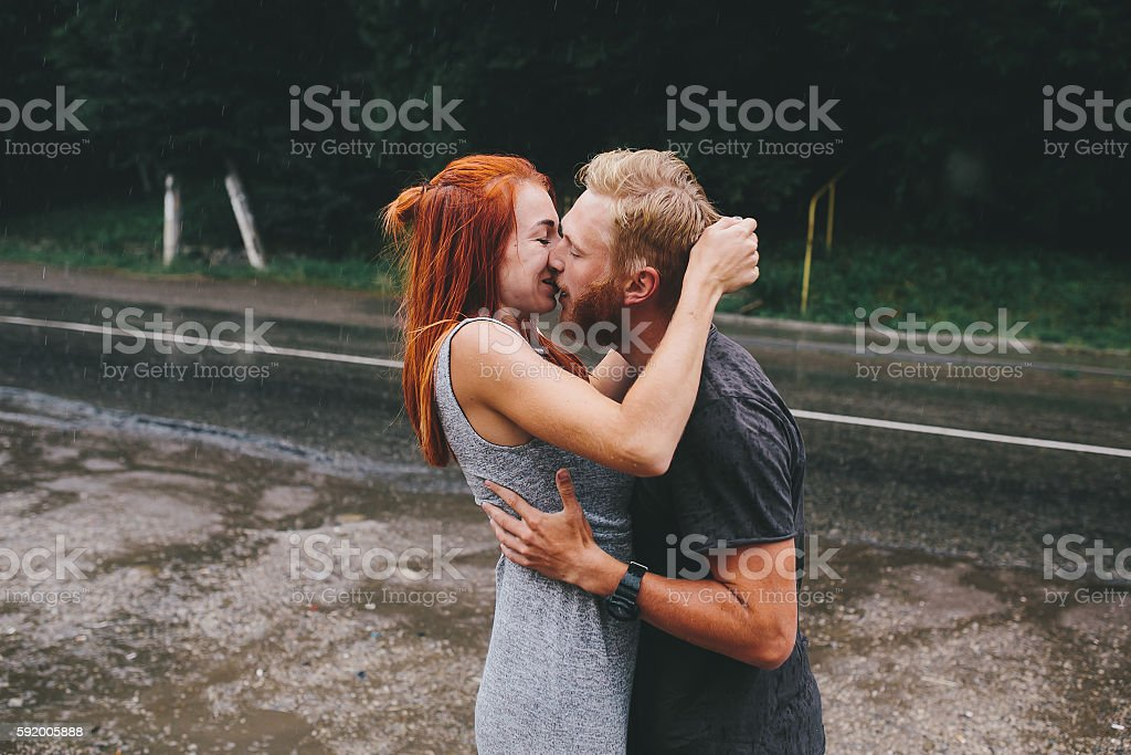man throws up his girlfriend stock photo