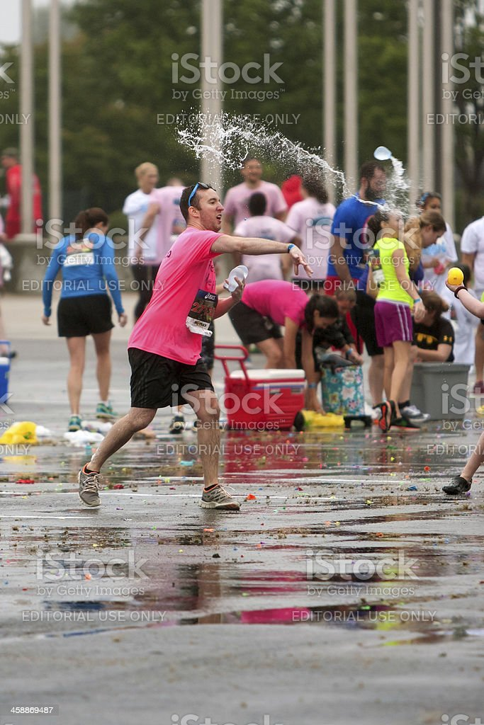 Man Throws Water Balloon In Group Fight After 5K Race royalty-free stock photo