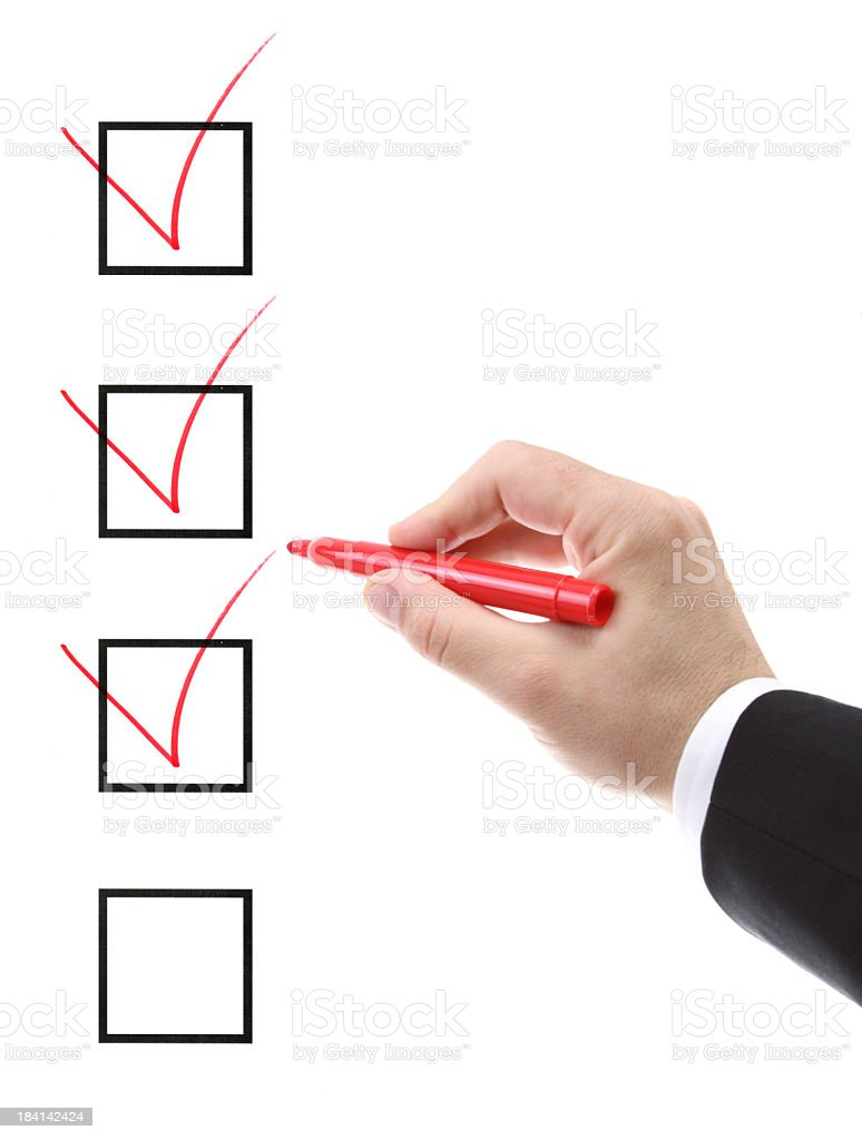 A man ticking check boxes with a red marker stock photo