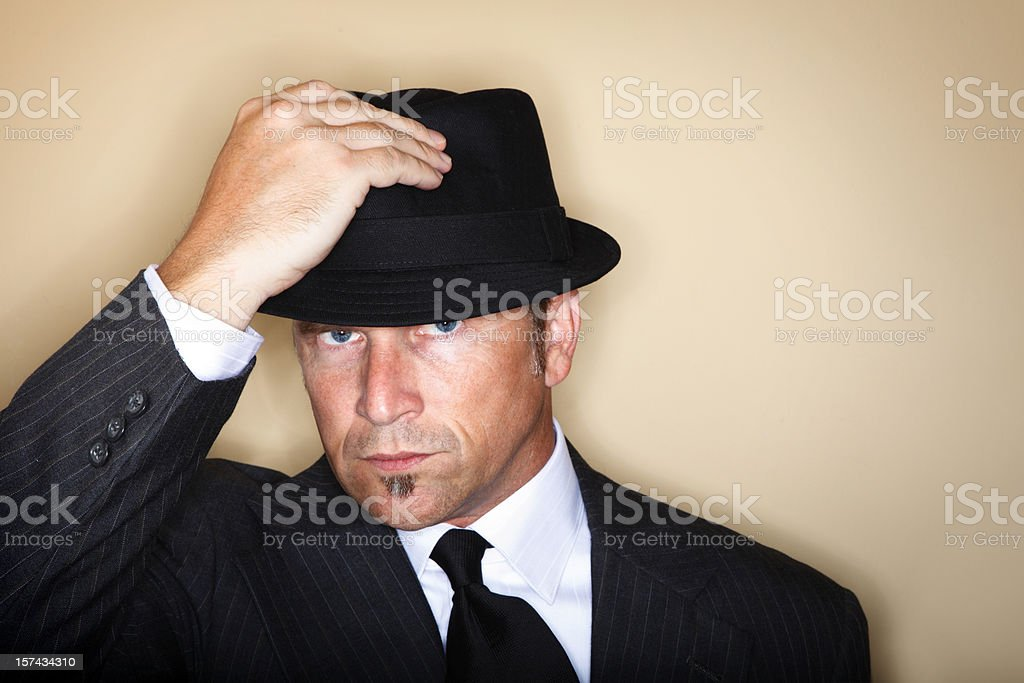 Man Tipping Hat stock photo