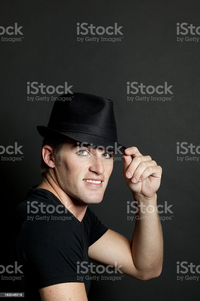Man Tips Fedora Hat, Smiling, Handsome stock photo
