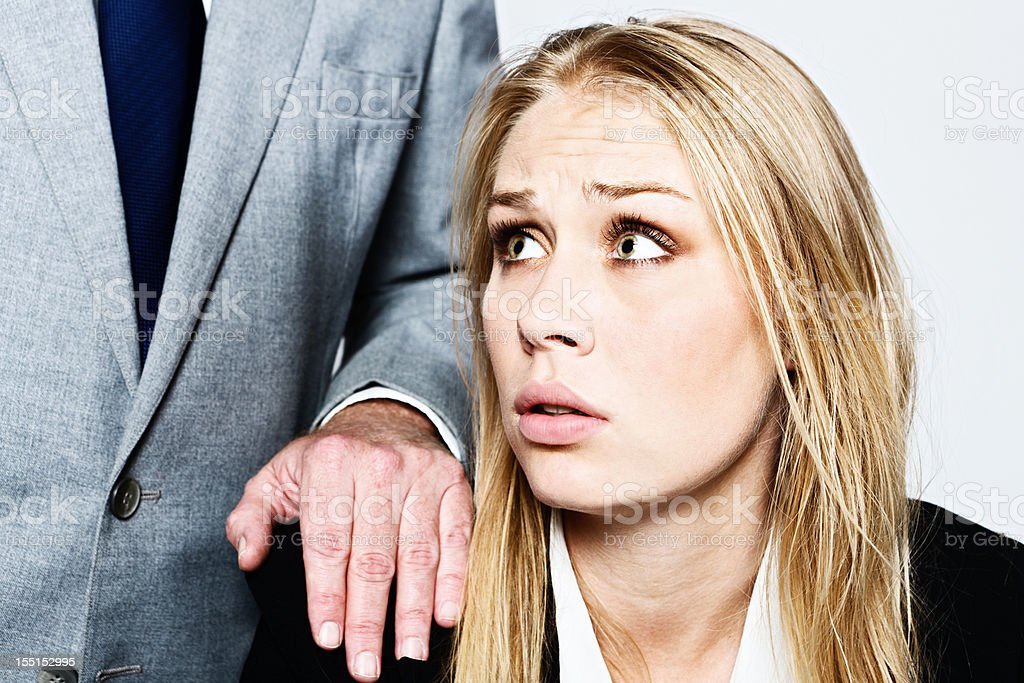 Man touches pretty businesswoman: accusation or harassment? royalty-free stock photo