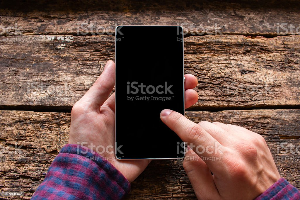 man touches the screen in the phone mockup stock photo