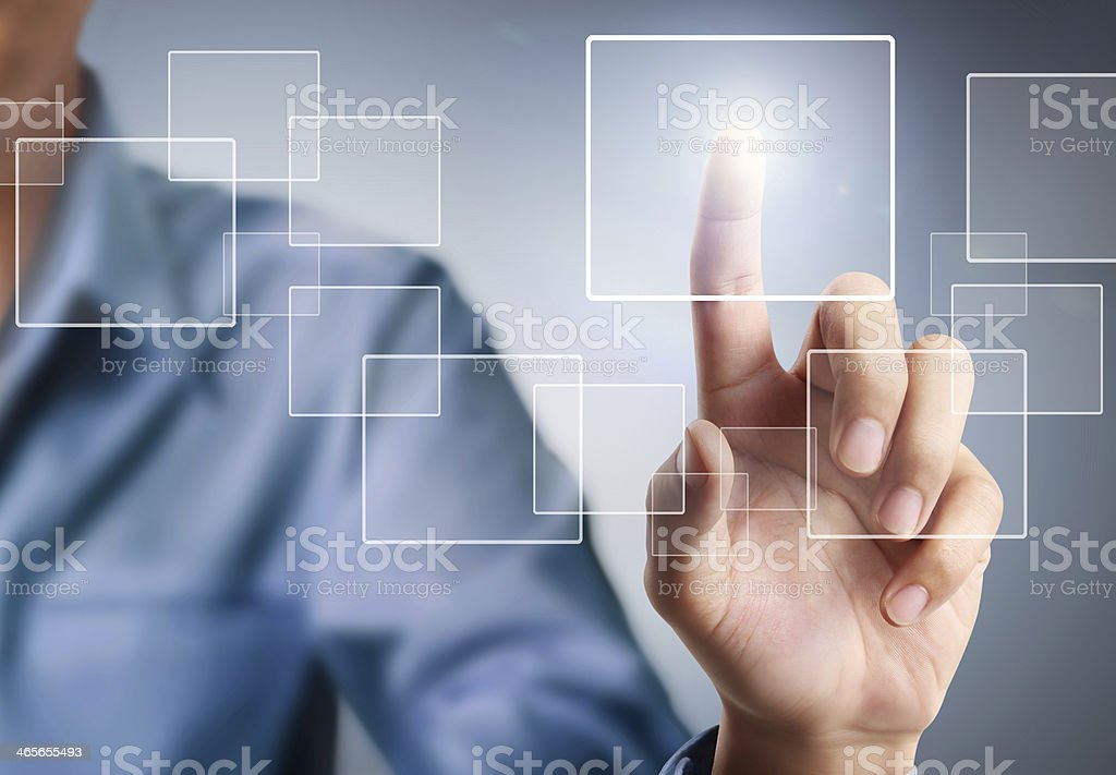 Man touching a square in the air stock photo