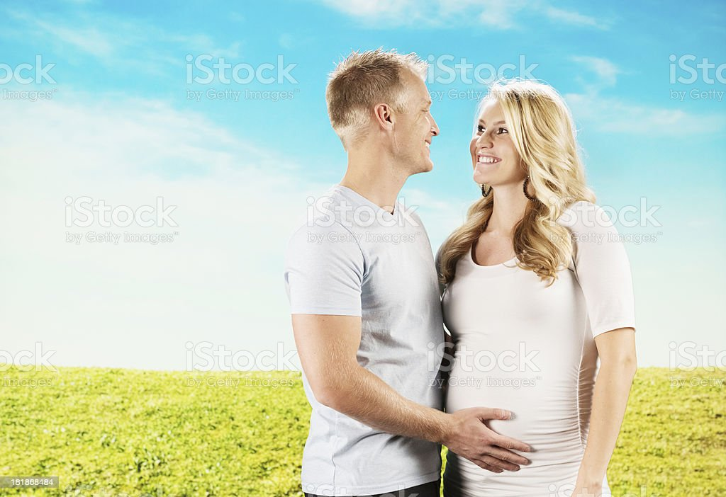 Man touching abdomen of his pregnant wife royalty-free stock photo