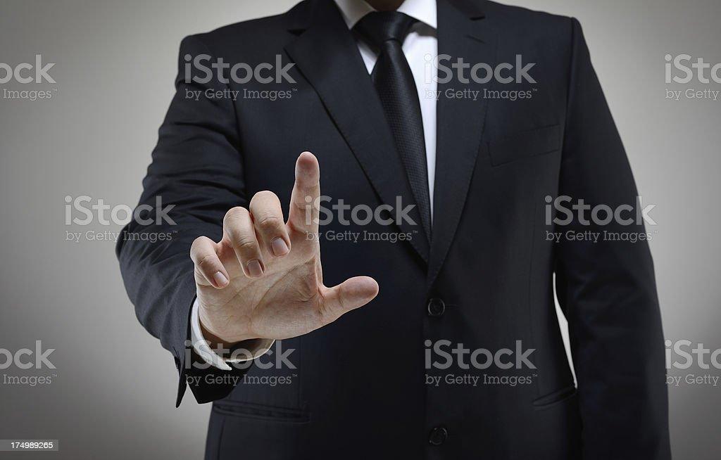 Man touching virtual screen stock photo