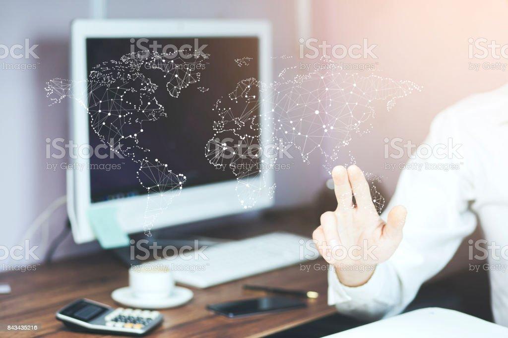 Man touching virtual world map by hand stock photo
