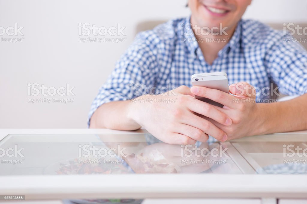 Man toying with the Smartphone stock photo