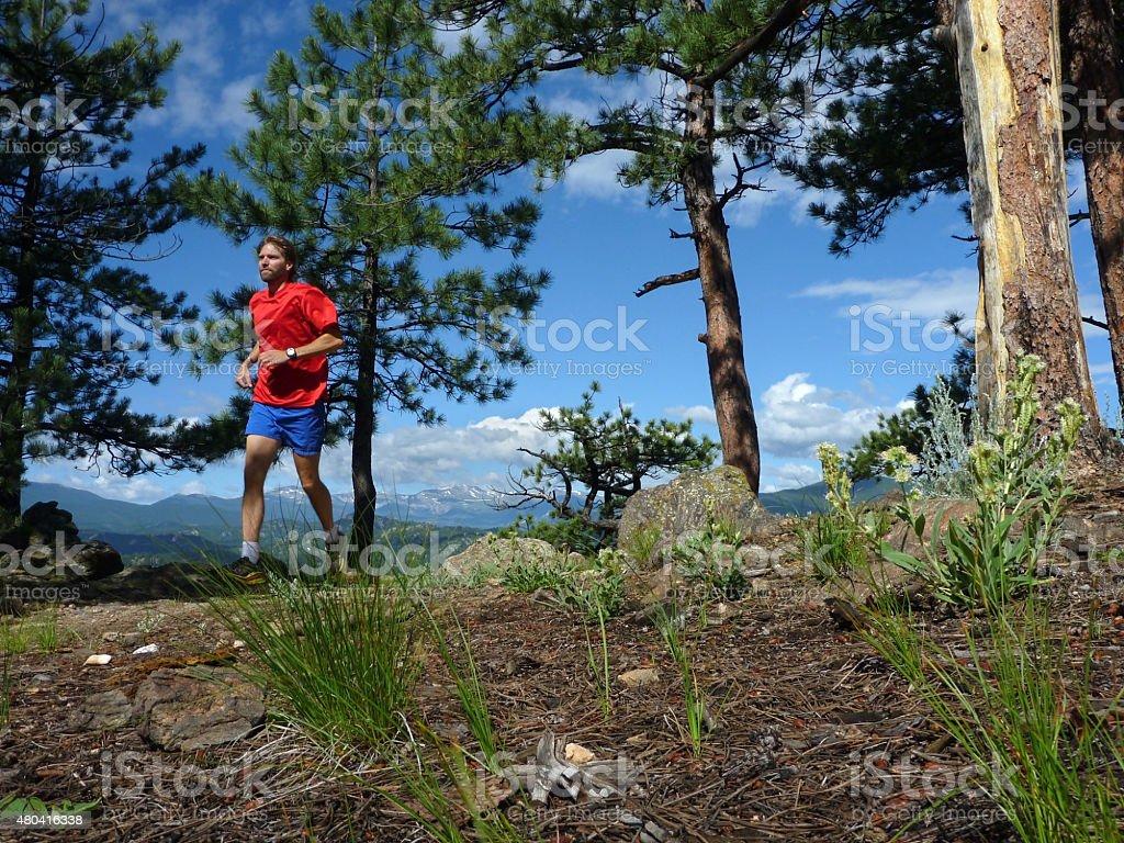 Man trail runs Bear Creek Mount Evans Colorado Rocky mountains stock photo