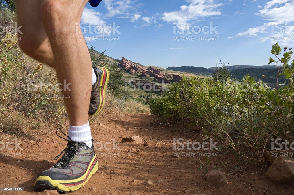 Man trail runs Mount Falcon past Red Rocks Colorado mountains stock photo
