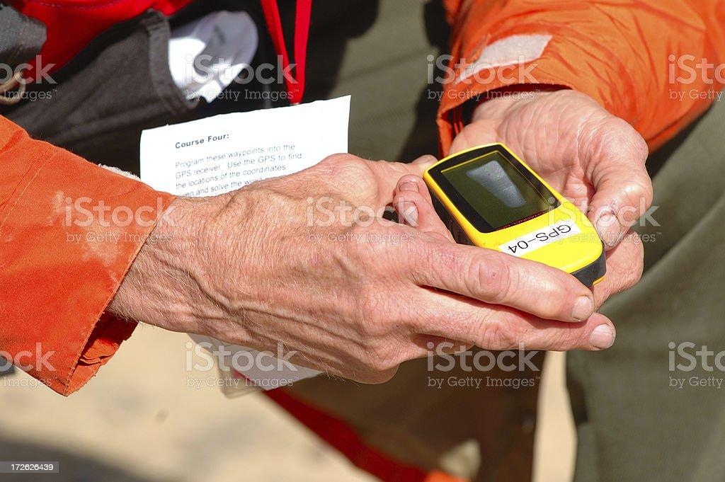 Man training, holding GPS unit royalty-free stock photo