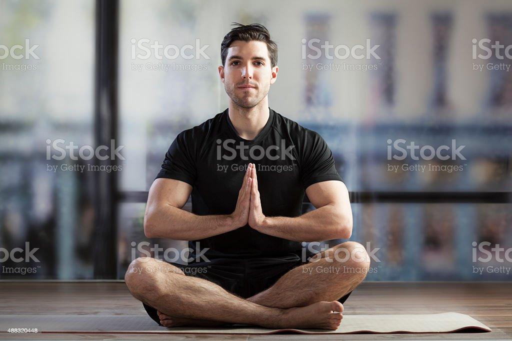 man training yoga stock photo