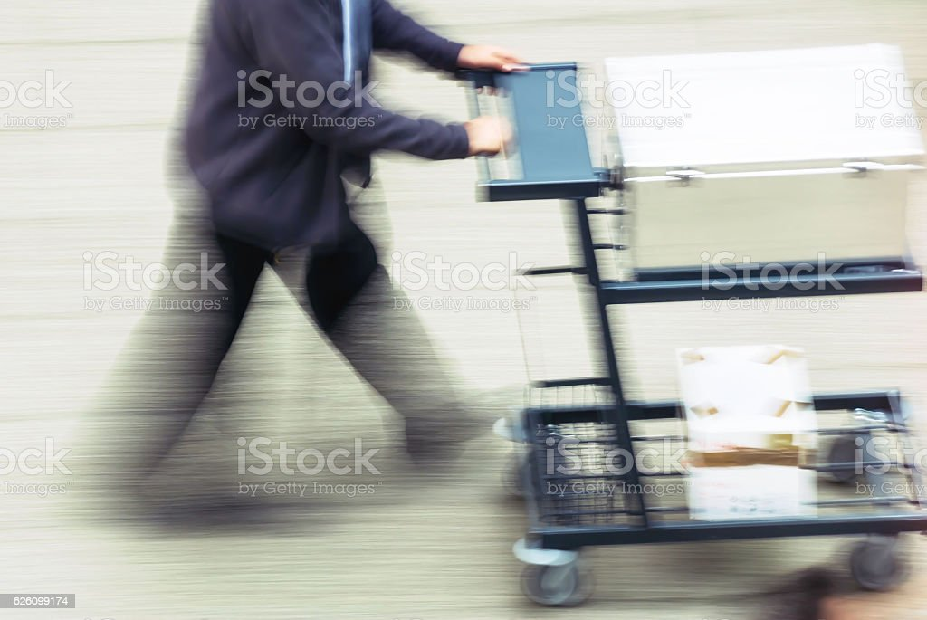 man transporting merchandise in a street stock photo