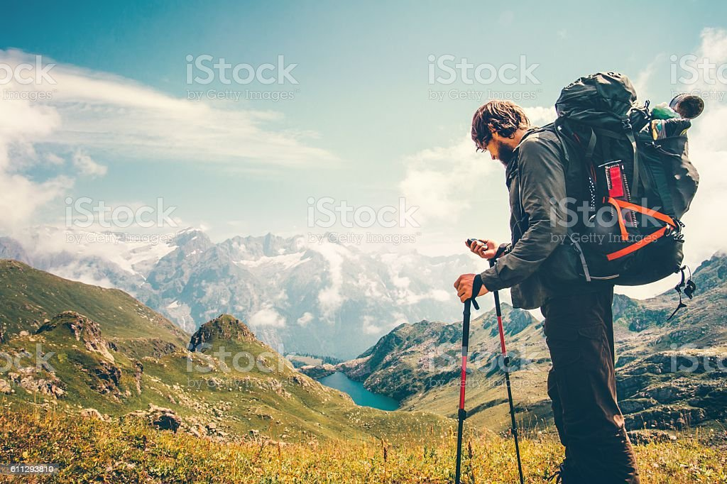 Man Traveler backpacker with gps navigator tracker stock photo