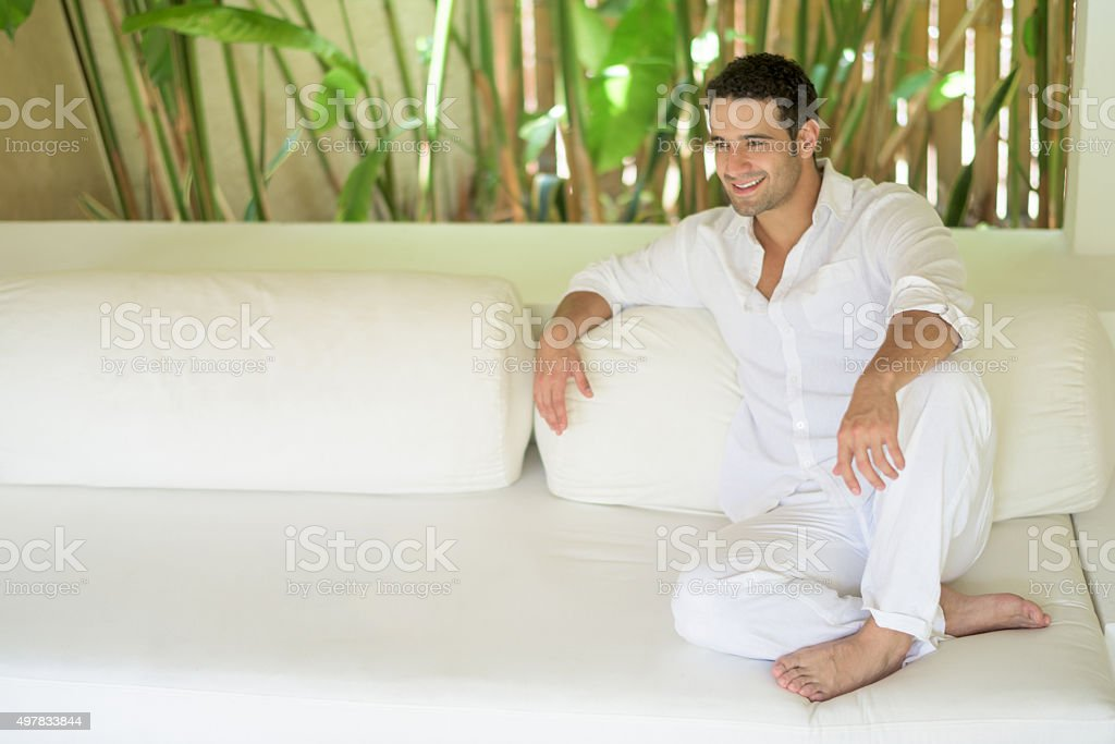 Man traveling and relaxing at the hotel stock photo