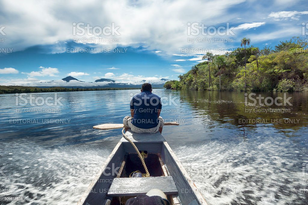 Man traveling in a canoe, in Canaima National Park stock photo