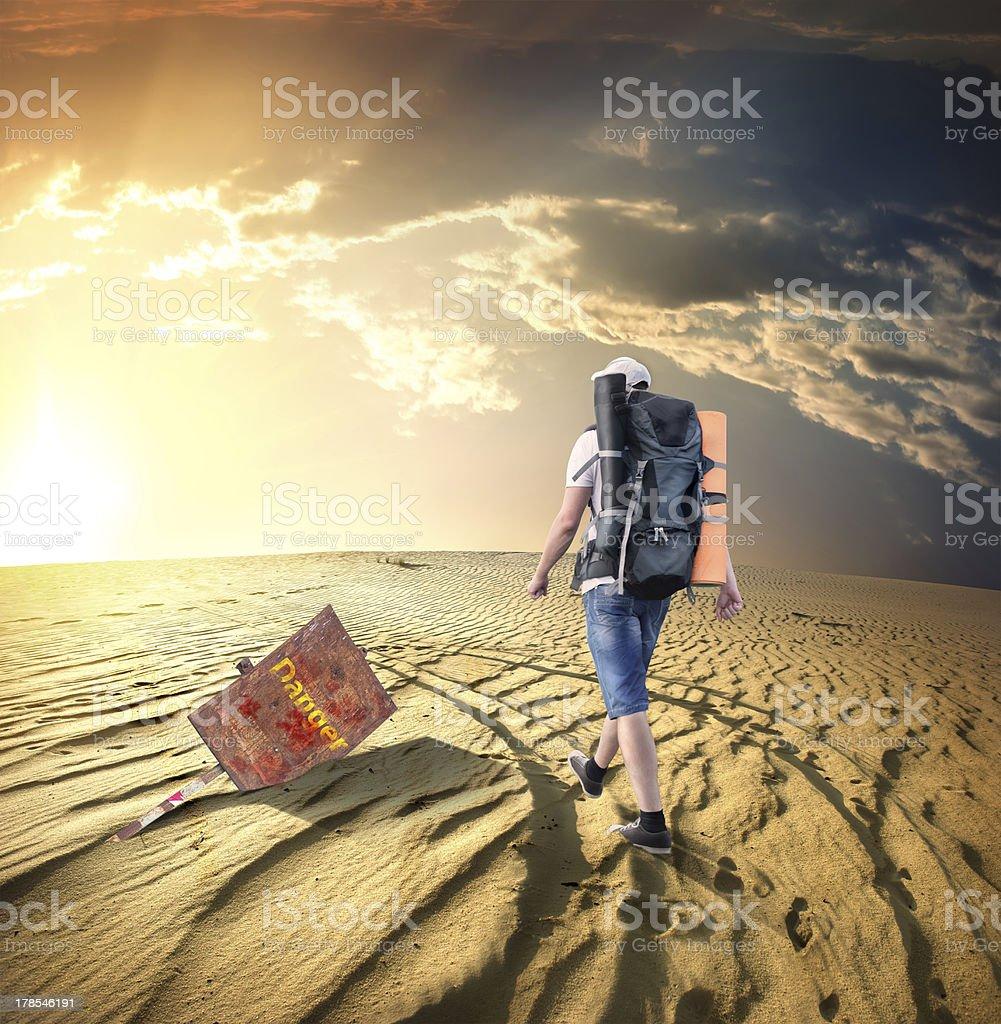 Man traveling in desert royalty-free stock photo
