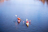 Man traveling on the river in a kayak
