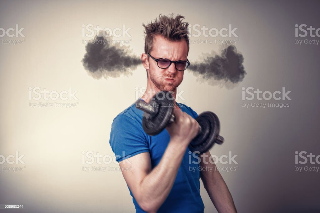 Man trying to build muscle stock photo