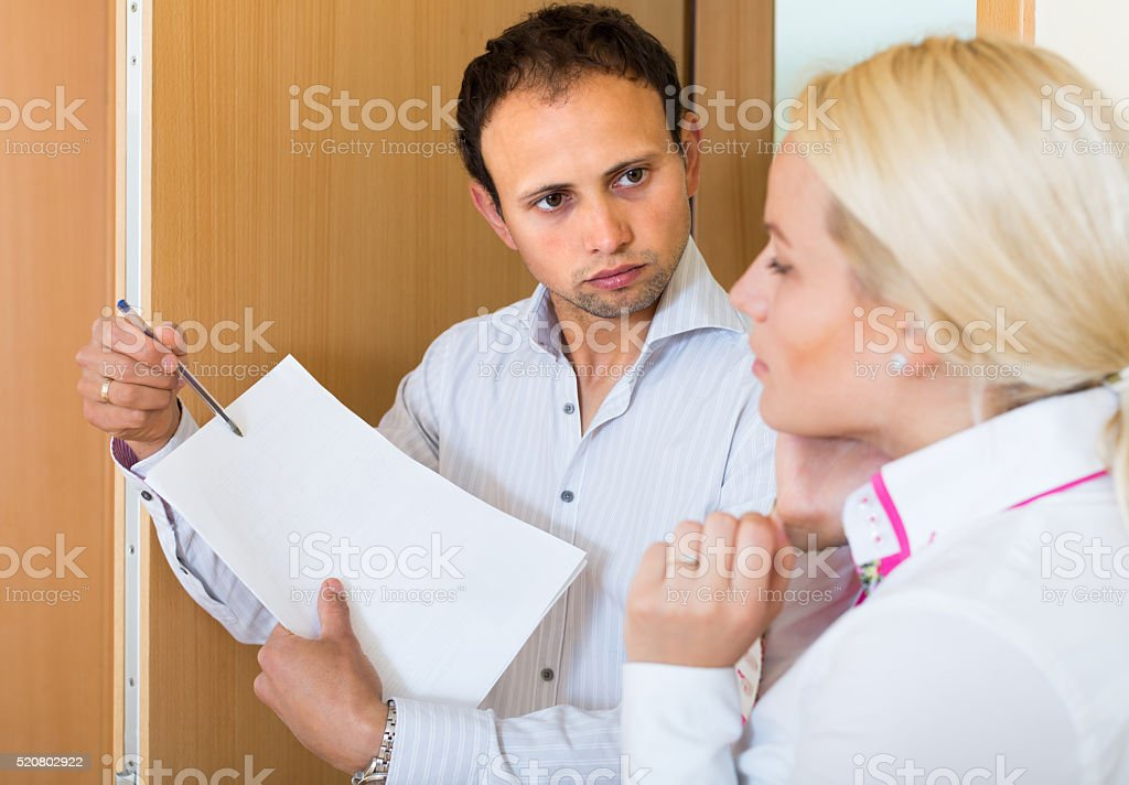 Man trying to collect arrearages from woman stock photo