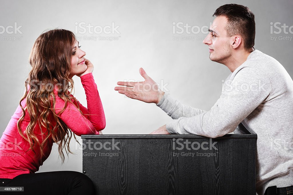 Man trying to reconcile with woman after quarrel. stock photo